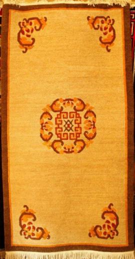 Tibetan carpet with coin design in center