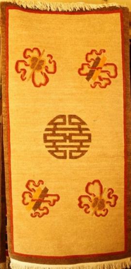 Tibetan carpet with coin and auspicious symbol