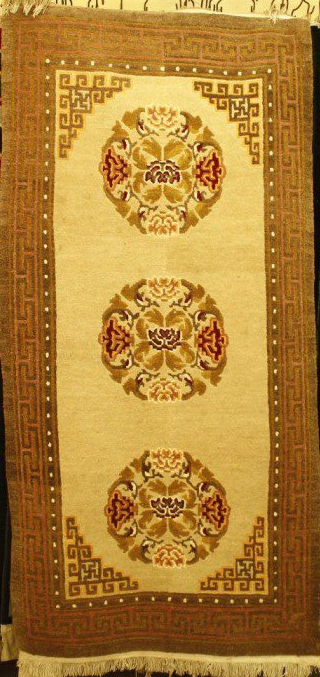 Tibetan carpet with 3 coins and border